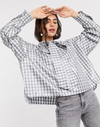 Ghospell oversized shirt in high shine blue check with pussybow tie