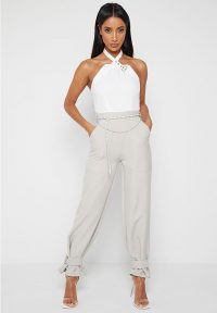 Manière De Voir HALTERNECK JUMPSUIT WITH CHAIN BELT WHITE/STONE