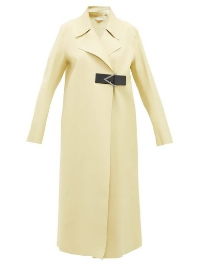 Kylie Jenner pale yellow coat, BOTTEGA VENETA Laser-cut geometric-buckle midi-length rubber coat, at Nobu restaurant in Malibu, 10 June 2020 | celebrity outerwear | coats | street style - flipped