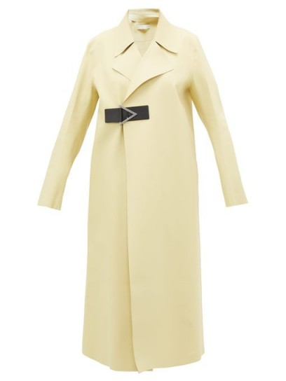 Kylie Jenner pale yellow coat, BOTTEGA VENETA Laser-cut geometric-buckle midi-length rubber coat, at Nobu restaurant in Malibu, 10 June 2020 | celebrity outerwear | coats | street style