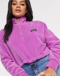 Mossimo cropped polar fleece in purple / logo prints