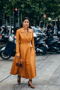 Caramel leather fit and flare coat with tonal accessories