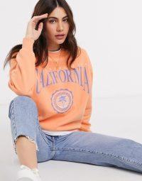 Pull&Bear varsity sweatshirt in orange / California slogan sweat top