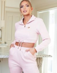 The O Dolls Collection high neck zip detail crop hoody with logo in pink / cropped hoodies