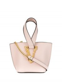 Versace Virtus logo plaque bucket bag in light pink / small luxe handbag