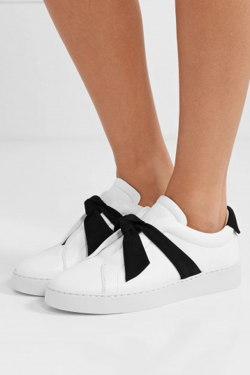 Olivia Palermo white and black front tie trainers, ALEXANDRE BIRMAN Clarita bow-embellished suede-trimmed leather slip-on sneakers, out in New York, 30 May 2020 | casual celebrity street style