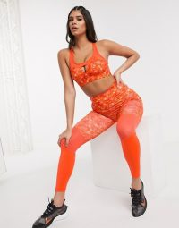 Wolf & Whistle Eco set with bra and leggings in orange jungle print with mesh panels