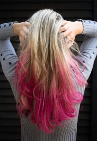 Blonde and dyed pink hair