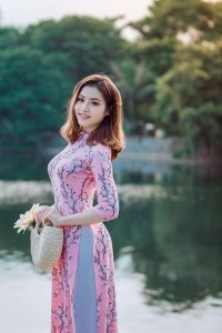 Lake side beauty and style. Love this pink dress