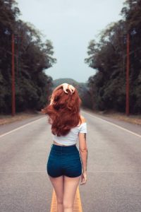 Full head of dark red hair. On the road fashion