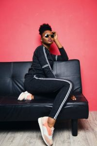 Dark navy track suit, sunglasses and peach trainers – ultimate style