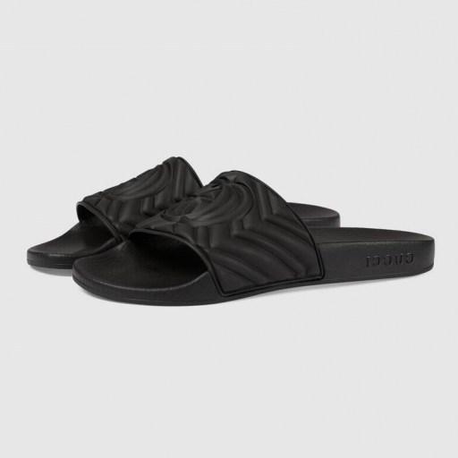 Olivia Munn black slides worn leaving the gym, 29 July 2020, GUCCI matelassé rubber slide | casual celebrity footwear - flipped