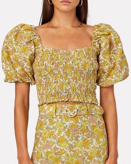 Dakota Fanning yellow puff sleeve top, FAITHFULL THE BRAND Robina Smocked Floral Crop Top, on Instagram, 13 July 2020   celebrity social media fashion - flipped
