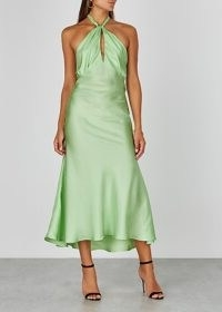 MAGGIE MARILYN She's Got Her Groove Back silk midi dress | green slinky halterneck dresses | fluid fabric fashion