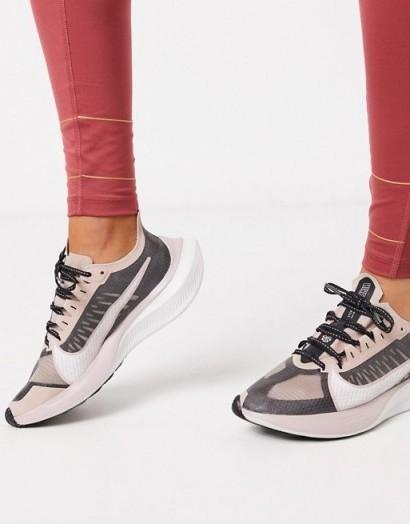 Nike Running Zoom Gravity in black and rose gold – Asos