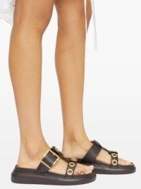ALEXANDER MCQUEEN Raised-sole buckled leather slides | large buckle and gold eyelet sandals