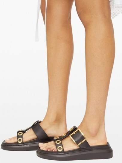 ALEXANDER MCQUEEN Raised-sole buckled leather slides   large buckle and gold eyelet sandals - flipped