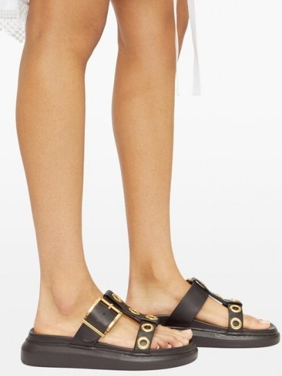 ALEXANDER MCQUEEN Raised-sole buckled leather slides   large buckle and gold eyelet sandals