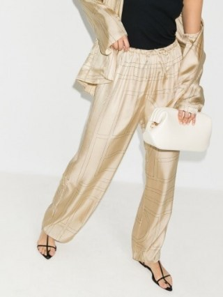 Hailey Bieber cream printed trousers, Totême Vizelle Monogram Silk Trousers, worn on Instagram, 29 July 2020 | celebrity social media style - flipped