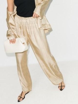 Hailey Bieber cream printed trousers, Totême Vizelle Monogram Silk Trousers, worn on Instagram, 29 July 2020 | celebrity social media style