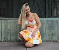 Summer fashion. Multi-coloured white flowered dress