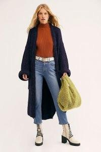 Selena Gomez blue longline cardigan, free people Live In Tokyo Cardigan in navy sky, on Hbo Max, Instagram, 27 August 2020 | celebrity social media style | knitwear | fashion