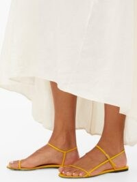 THE ROW Bare leather sandals in yellow / barely there flats