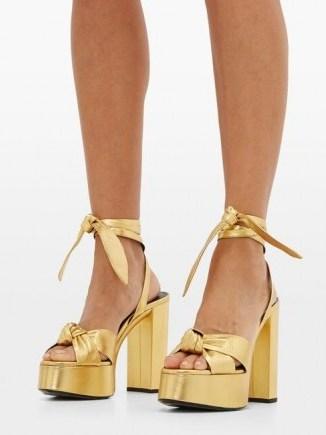 Kate Beckinsale gold ankle tie platforms, SAINT LAURENT Bianca metallic-leather platform sandals, on Instagram, 8 August 2020 | celebrity social media heels | star footwear - flipped