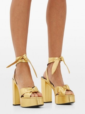 Kate Beckinsale gold ankle tie platforms, SAINT LAURENT Bianca metallic-leather platform sandals, on Instagram, 8 August 2020 | celebrity social media heels | star footwear