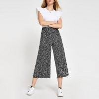 RIVER ISLAND Black spot print wide leg culottes / crop leg trousers