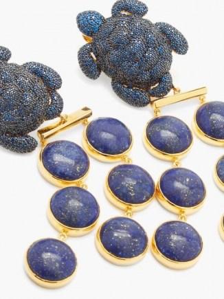 BEGUM KHAN Caretta Mustique 24kt gold-plated clip earrings / blue stone statement jewellery / lapis lazuli drops / crystal turtle drops - flipped