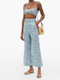 Chrissy Teigen blue floral flares worn with matching crop top for Instagram Stories, ZIMMERMANN Carnaby kick-flare floral-print linen trousers, 28 July 2020 | celebrity social media fashion | star style clothing