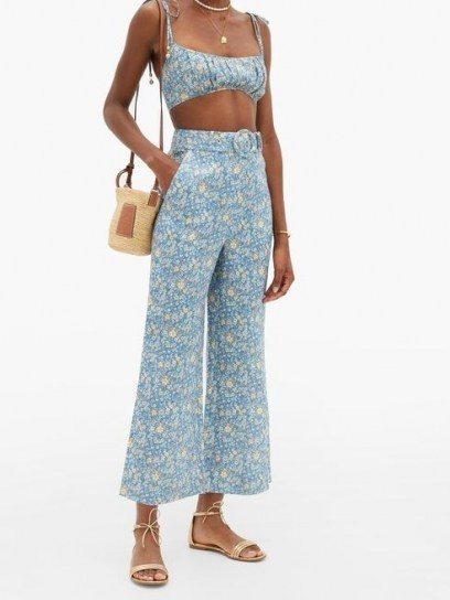 Chrissy Teigen blue floral flares worn with matching crop top for Instagram Stories, ZIMMERMANN Carnaby kick-flare floral-print linen trousers, 28 July 2020 | celebrity social media fashion | star style clothing - flipped