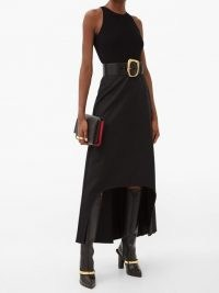 ALEXANDER MCQUEEN Dip-hem wool skirt in black / contemporary fashion / high low skirts