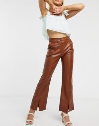 Ghospell tailored flared trousers in brown faux leather / split hem pants