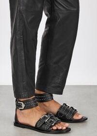 GIVENCHY Elegant black studded leather sandals / buckle detailed flats / flat ankle strap sandal / stud detail