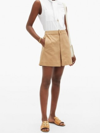 GIVENCHY Lock-hardware cotton-gabardine mini skort in beige ~ chic skorts - flipped