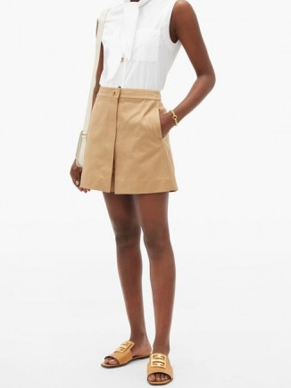GIVENCHY Lock-hardware cotton-gabardine mini skort in beige ~ chic skorts