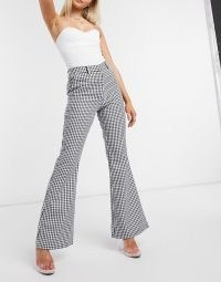 NA-KD houndstooth print flared trousers in black | checked flares