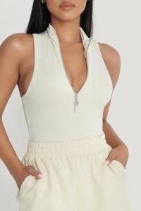 MESHKI PAULINA Sleeveless High Neck Zip Bodysuit ~ fitted zipper front bodysuits