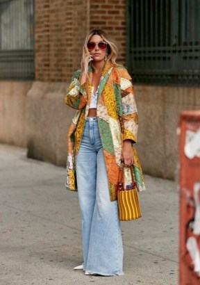 Exaggerated flares and patchwork coat | boho street style | faded denim