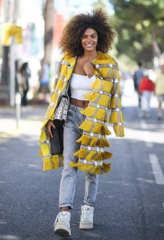 Grey straight leg jeans, white crop top and yellow fringed coat | inspirational street style looks | outfits with denim