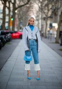 Bright blue turtleneck under grey oversized cardigan with LOEWE Fisherman turn-up cuff jeans | inspirational denim outfits | outfits with denim
