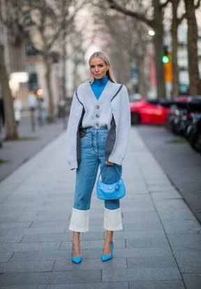 Bright blue turtleneck under grey oversized cardigan with LOEWE Fisherman turn-up cuff jeans | inspirational denim outfits | outfits with denim - flipped