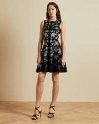 TED BAKER NAOMYY Rhubarb jacquard knitted skater dress in black / sleeveless fit and flare dresses – floral lbd