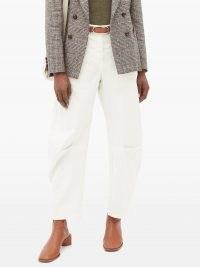 NILI LOTAN Carpenter pleated-leg cropped jeans in cream | neutral denim