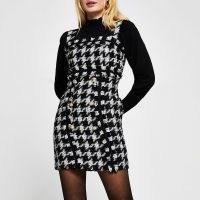 RIVER ISLAND Black sleeveless boucle mini dress / tweed style pinafore dresses / checked fashion / large dogtooth checks
