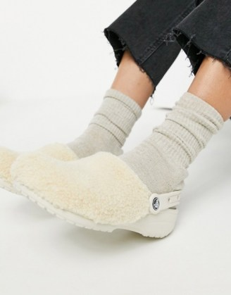 Crocs classic fuzz mania clogs in cream | fluffy footbed shoes - flipped