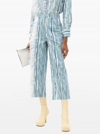 THEBE MAGUGU Feather-trimmed shredded denim-print cotton jeans