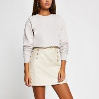 River Island Stone PU quilted mini skirt – neutral button detail skirts – faux leather fabrics